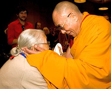 The Dalai Lama interacts with a devotee