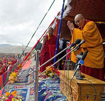 The Dalai Lama greets Tibetan exiles