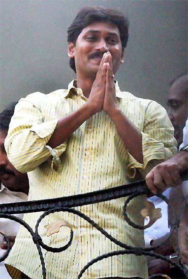 Jagan Reddy greets supporters after quitting Congress, at his Hyderabad residence on Monday