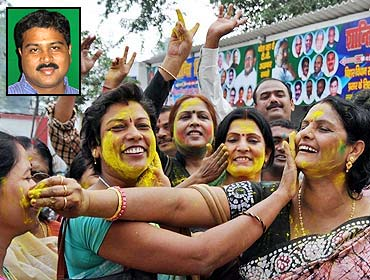 Janata Dal-United supporters celebrate after the victory of the BJP-JD-U combine in the elections. (Inset): Dharmendra Pradhan, BJP general secretary-in-charge of Bihar