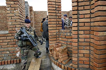 A French army officer visits a police station in Shamilia, Afghanistan