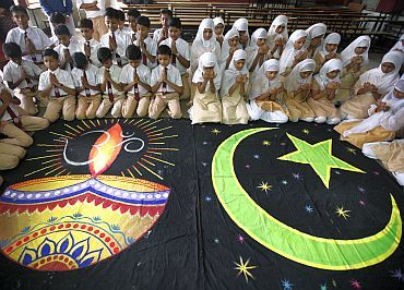 Hindu and Muslim school children offer prayers for peace inside their school in Ahmedabad