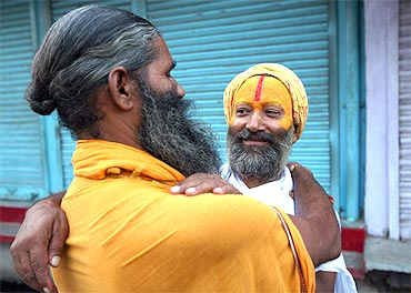Sadhus hug each other to celebrate the Ayodhya verdict