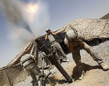 US soldiers from 1-75 Cavalry mortars, a part of 2nd Brigade, 101st Airborne, fire 120mm mortars at an enemy position in Kandahar province on September 4