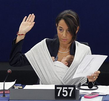 Italy's Member of the European Parliament Licia Ronzulli takes part with her baby in a voting session at the European Parliament in Strasbourg on September 22