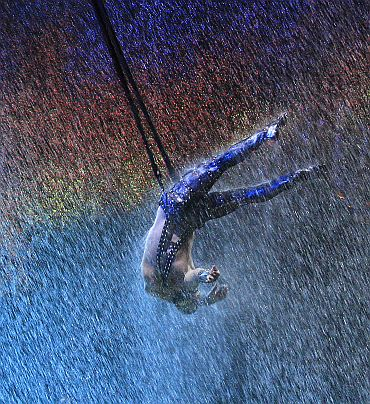 A performer takes part in a show 'The House of Dancing Water' at the City of Dreams resort in Macau on September 15, 2010. The 256 million dollar water-based show, created and directed by Franco Dragone, is inspired by the 'seven emotions' principle derived from classical Confucian beliefs in Chinese culture