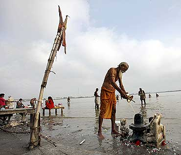 A man prays on the banks of river Saryu in Ayodhya