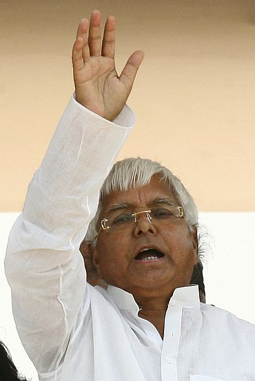 Lalu Prasad Yadav waves to his supporters
