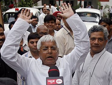 Lalu (L) addresses the media as senior communist leader Sitaram Yechury looks on