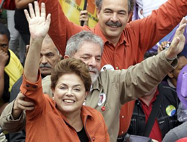 File photo shows Dilma Rousseff with her mentor, Luiz Inacio Lula da Silva, waving to the crowd during a campaign rally in Sao Bernardo do Campo on October 2