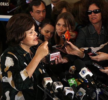 File photo shows Dilma Rousseff gesturing as she speaks to the media after leaving a hospital in Sao Paulo May 20, 2009