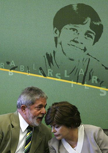 File photo shows Luiz Inacio Lula da Silva and Dilma talking during the inauguration ceremony of Institutional Relations Minister Alexandre Padilha at the Itamaraty Palace in Brasilia September 28, 2009
