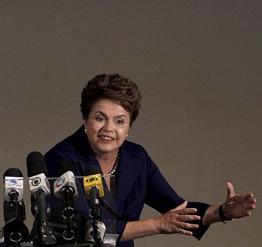 File photo shows Dilma talking to journalists during a news conference in Sao Paulo