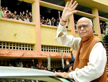 Advani waves as he comes out of a district court in Rae Bareli in July, 2005