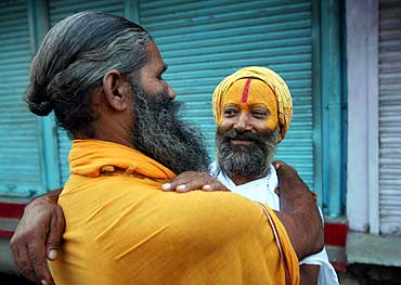 Sadhus hug each other after hearing the first reports of the Ayodhya verdict on September 30