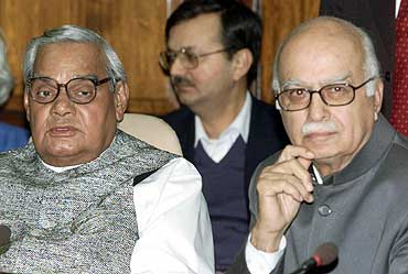 Former PM Vajpayee (left) and then home minister Advani attend a meeting in New Delhi in Feb' 02