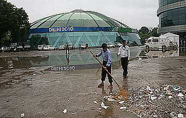 Sweepers cleaning a CWG venue