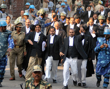 Paramilitary troopers escort lawyers for the Ayodhya case litigants in Lucknow