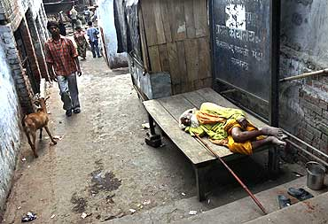 A man sleeps on a street in Ayodhya