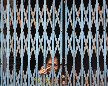 A woman looks out of her house in Ayodhya