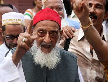 An elderly Muslim man takes part in a peace rally in Mumbai