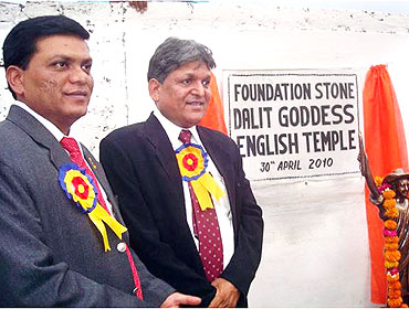 Chandrabhan Prasad, right, at the foundation laying ceremony of the temple to Goddess English
