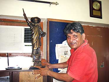 Chandrabhan Prasad at his home with a replica of the Goddess English