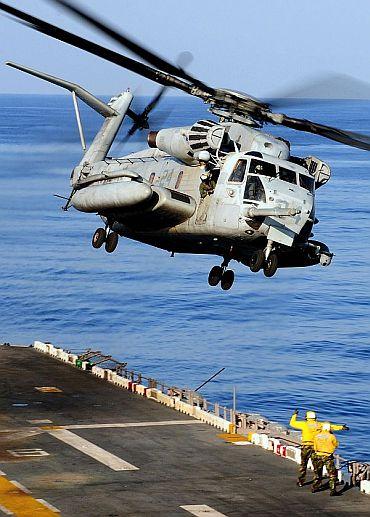 A CH-53E Sea Stallion helicopter assigned to Marine Medium Helicopter Squadron (HMM) 262, takes off