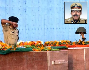CRPF jawan pays his last respects to colleagues who died in a Naxalite attack in Chhattisgarh. Inset:K Vijay Kumar