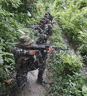 Security forces patrol a Maoist-infested zone