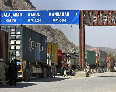 Trucks carrying NATO supplies wait in line at the Pakistan-Afghan border area of Torkham