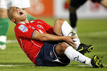 Chile's Humberto Suazo reacts after a foul during a soccer match