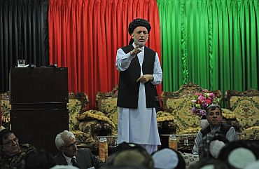 Afghan President Hamid Karzai speaks at a meeting with tribal leaders in Kandahar