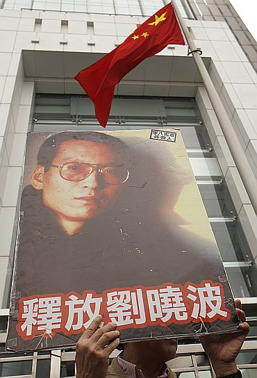 A protester holds a poster of one of China's best known dissidents Liu Xiaobo, outside the Chinese liaison office, during a protest in Hong Kong urging for Liu's release on January 25