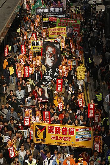 Protesters take to the streets in a march in support of jailed Chinese dissident Liu Xiao Bo, in Hong Kong on January 1