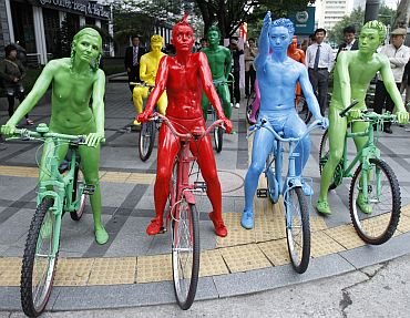 Performers covered in body paint wander around the streets during their street performance 'Coloured People' as part of the Hi Seoul Festival 2010 in central Seoul. The festival is an annual cultural event which includes international non-verbal performances such as circus acts, mimes and puppet shows. Events will take place on the streets of Seoul and will run from October 2-10