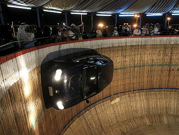 People watch a stunt driver perform at the 12th Abha Festival in Saudi Arabia on October 6