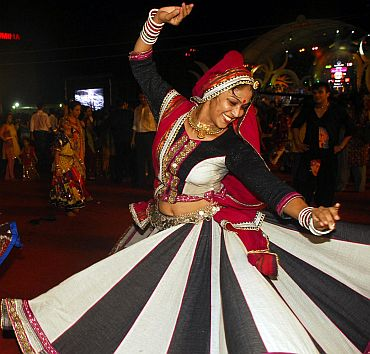 A young woman takes part in Garbha celebrations in Mumbai