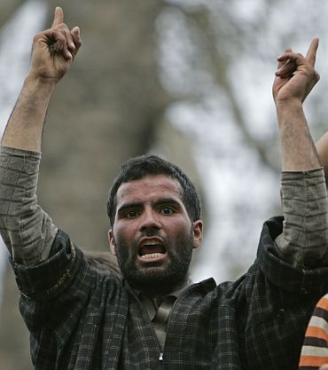 A Kashmiri protester shouts pro-freedom slogans during the funeral of two militants after a gun battle between army and rebels near Srinagar