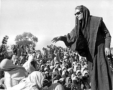 Indira Gandhi speaks to villagers during a political rally