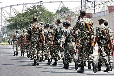 Paramilitary troopers patrol outside Jawaharlal Nehru stadium in New Delhi