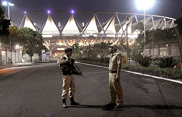 Policemen stand guard outside the Jawaharlal Nehru Stadium