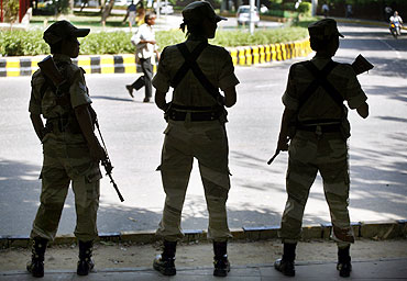 Security force personnel stand guard in New Delhi