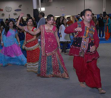 Young couples in traditional attire participate in the Navratri celebrations
