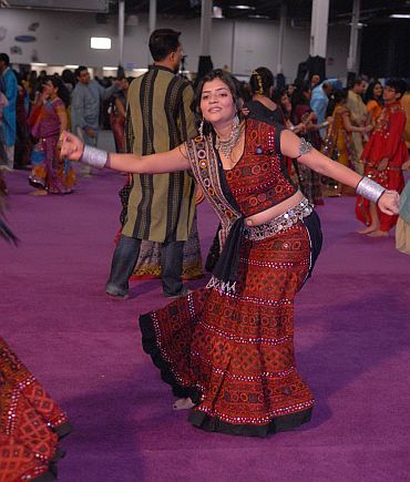 An Indian American does the garba