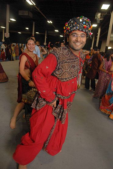 A couple in traditional attire takes part in the Navratri celebrations