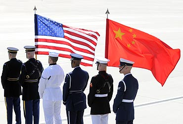 A colour guard of US and Chinese flags awaits President of China Hu Jintao's plane