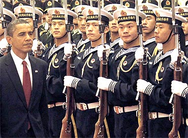 US President Barack Obama inspect honour guards during a welcome ceremony at the Great Hall of the People in Beijing