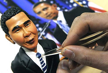 An artist crafts a figurine made from flour and water of US President Barack Obama in Shenyang, China