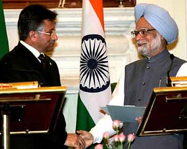 File photo shows Prime Minister Manmohan Singh shaking hands with Musharraf after making a joint statement in New Delhi on April 18, 2005